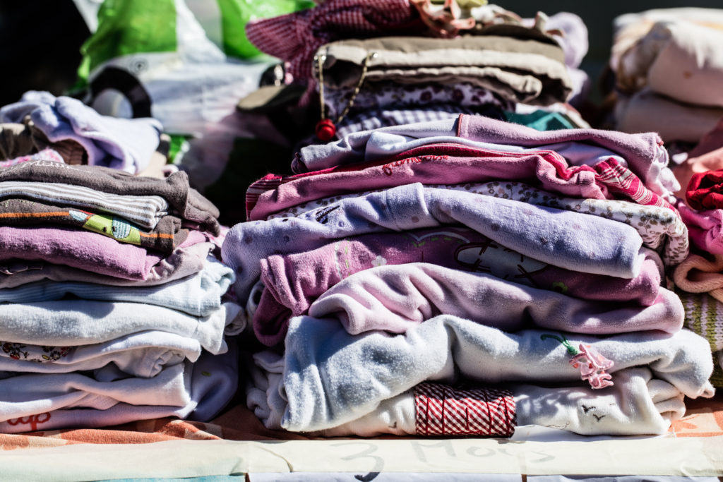 Clothing and accessories are one of the many things to flip for profit.  This image includes a stack of clothes.